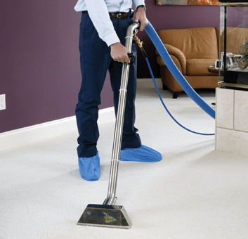 Carpet Cleaning, Man cleaning white carpet with carpet cleaning machine - carpet cleaning minneapolis