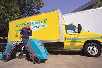 servicemaster van with man walking
